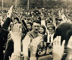 Hitler shows his famous serious look to adoring BDM girls at an RPT rally.