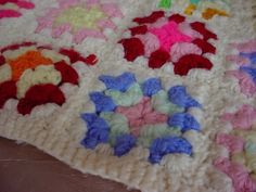 Small sized granny square afghan for doll or teddy :)