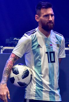 Lionel Messi poses with the official match ball for the 2018 World Cup football tournament, named 'Telstar 18', during its unveiling ceremony in Moscow on November 9, 2017