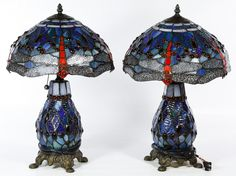 Lot 156: Tiffany Style Dragonfly Stained Glass Lamps; Two lamps having a dragonfly motif on the shades