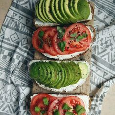 Bread with avocado, tomatoes, basil and freshly grounded pepper.