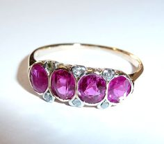 My ring 14 kt gold ring with 4 almost eye-clean no heated burman rubies totalling 2 ct and 6 diamonds