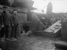 Shell hole in a casemate on HMS Kent. Sergeant Mayes RMA stands to the left of the hole: the Battle of the Falkland Islands 8th December 1914 http://www.britishbattles.com/battle-of-the-falkland-islands/