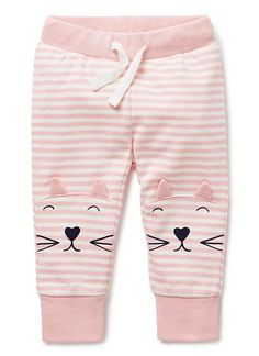 100% Cotton Trackie. French terry track pant in yarn-dyed stripe. 1x1 rib trim waistband with herringbone drawstring, and ribbed cuff. Features kitty print at knee with applique ears. Regular fit, with tapered leg. Available in Marshmallow.