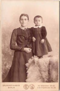 Vintage cabinet card of German mother with boy in dress