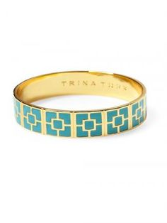 Turquoise enamel brightens up a gold bangle and gives it a playful, South Beach vibe. Trina Turk bangle. #moremagazine
