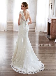Slim A-line wedding dress with scalloped V-neckline and open back, Pilar by Maggie Sottero.