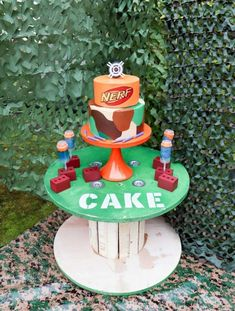 Epic Outdoor NERF Themed Birthday Party Cake Idea Kids will love - plus, a recipe for NERF bullet inspired dessert treat pops! Get details and more NERF party inspiration now at fernandmaple.com!