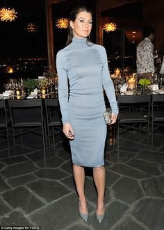 Shades of Grey: The 44-year-old showed off her lean physique in the fitted neutral number ...