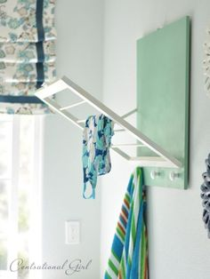 Melanie at Centsational Girl coveted a flip-out drying rack for her laundry room — so she made one herself! Pre-cut wood, knobs and spray paint come together to create this stealthy hang-drying helper. Get the tutorial here »
