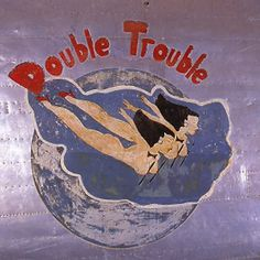 """""""Double Trouble"""" from the Confederate Air Force Collection.  This collection of nose art panels came to the CAF from Minot Pratt, the general manager of the company that was scrapping planes at the boneyard at Walnut Ridge, Arkansas.  He had ordered his men to cut out and save the most interesting nose art, which he was supposedly going to put up as a fence around his property.  This never happened and he donated the pieces to the CAF in the 1960's."""