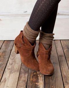 Charcoal tights, gray bunched socks, light gray booties.