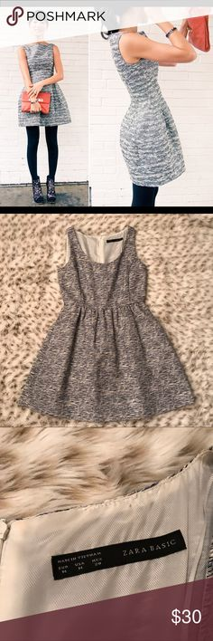 Zara Basic Metallic Tweed Tulip Dress Zara basic tulip Metallic tweed dress! Size medium! So cute and classy! Excellent used condition! Zip up back closure. Pockets on both sides of Dress! Classy yet comfy! Approx 33.5 inches from shoulder to hem. Navy blue silver Metallic and white colored tweed Zara Dresses Mini