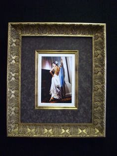 Stunning wedding photo showcased in #Bellini fine moulding and filet, enhanced with a suede mat board. Design and custom framing by Framing to a T.