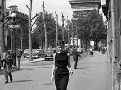 rareaudreyhepburn:  Audrey Hepburn photographed by Marcel Thomas in front of the Arc de Triomphe in Paris, France, June 1956.
