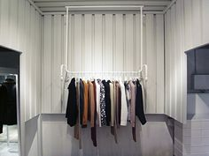Maison Martin Margiela, Tokyo.  In some areas, metal cladding is used to divide the space and a 'clothes rack' hanger rack