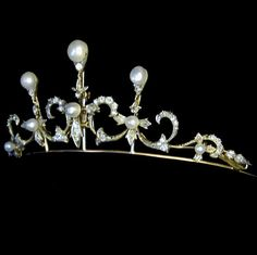 Victorian pearl and diamond tiara, the three stylised fleur-de-lys motifs set with a single pearl surrounded by old brilliant-cut and rose-cut diamonds, each motif surmounted by three pearls and a single diamond, with a pearl and diamond set scroll motif to each side, all in silver grain and cut-down settings on yellow gold back, convertible into necklace, approximate estimated diamond weight 3.4 carats, circa 1880