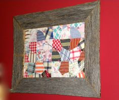 My Dad made this frame with wood from my grandparent's barn, then added a piece of an old quilt.