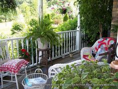 Country Decorated Front Porches | ... bold color in the quilts and cushions on her cozy country porch