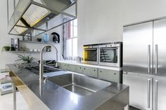 Luxurious ground floor apartment with two bedrooms, two bathrooms & separate w.c and utility room. Interior designed throughout with mezzanine floor. Open plan Boffi stainless steel kitchen. Master bedroom has a modern open plan en-suite bathroom with black granite flooring. #openplankitchen #kitchengoals #dreamkitchen #baffikitchen #openplanbathroom #ensuitbathroom #bathroomgoals #bedroomdesign #interiordesign #luxuryproperty #mezzanine