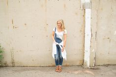 Shop this look for $88:  http://lookastic.com/women/looks/blue-overalls-and-white-cable-sweater-and-white-cropped-top-and-tan-wedge-sandals/3181  — Blue Denim Overalls  — White Cable Sweater  — White Cropped Top  — Tan Leather Wedge Sandals