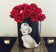 DIY hollywood vase centerpiece with Marilyn Monroe & red roses. Learn how to create this beautiful centerpiece at http://sparklerparties.com/blog/stunning-diy-hollywood-centerpiece/