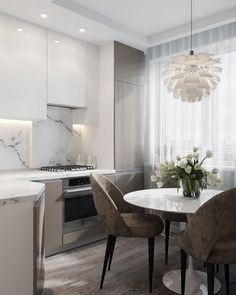 We LOVE this contemporary glass kitchen. Use our beautiful RAUVISIO crystal surfaces in your home: Kitchen Room Design, Modern Kitchen Design, Dining Room Design, Home Decor Kitchen, Kitchen Interior, Home Kitchens, Round Kitchen, Glass Kitchen, Kitchen Dining