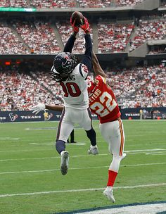 DeAndre Hopkins of the Houston Texans makes a touchdown catch against Marcus…