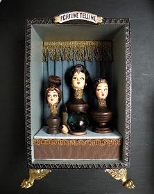 'Three Heads are Better than One' vintage doll heads, wooden finials, gold braid, silk, crystal ball, inside a wooden box with ...