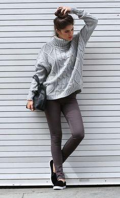 Shop this look on Lookastic:  http://lookastic.com/women/looks/grey-turtleneck-black-tote-bag-charcoal-skinny-jeans-black-slip-on-sneakers/6328  — Grey Knit Turtleneck  — Black Leather Tote Bag  — Charcoal Skinny Jeans  — Black Slip-on Sneakers