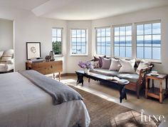 The master bedroom was moved to the old bathroom's location to take advantage of the prime lake  panorama. Much of the furnishings were part...