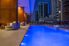After a long day, come enjoy a drink by the pool at Waldorf Astoria Panama.