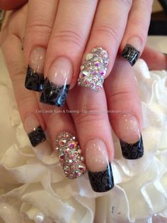 Grey polish tips with black freehand nail art and Swarovski ring fingers