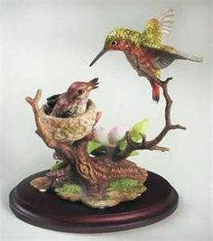 Momma and baby hummingbirds