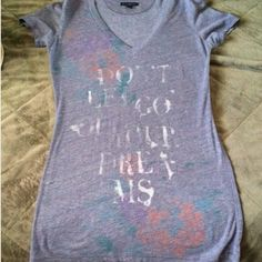 AEO v neck soft faded tee AEO , don't let go of your dreams . made to look old and faded ,still brand new only worn a few times . Beautiful lavender color :) so soft and stretchy ! American Eagle Outfitters Tops Tees - Short Sleeve