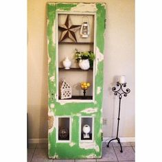 Antique Door transformed into a beautiful bookshelf using reclaimed wood.  A true one of a kind piece!  www.binspireddesigns.net / www.facebook.com/binspireddesigns