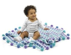 Pom-Pom Blanket looks like a fun one to make and one that baby will enjoy!