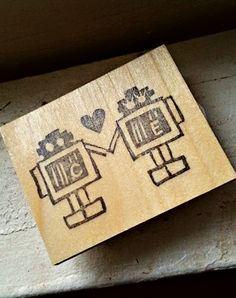 personalized robot love hand carved stamp. http://www.etsy.com/listing/62858928/customizable-robot-love-hand-carved