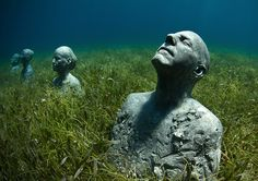 "Award-winning photographer and artist Jason deCaires Taylor produces a very unique type of public art, placing his awe-inspiring sculptures underwater.  ""Taylor's art is like no other, a paradox of creation, constructed to be assimilated by the ocean and transformed from inert objects into living breathing coral reefs, portraying human intervention as both positive and life-encouraging.  His pioneering public art projects are not only examples of successful marine conservation, but works..."