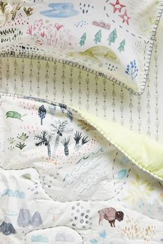 Wilderness forest, rustic toddler or baby quilt. So adorable Affiliate Toddler Quilt, Sleeping Under The Stars, Natural Bedding, Anthropologie, Childrens Beds, Textiles, Cozy Bed, Vernon, Girl Nursery