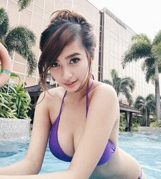 sexy asian hot babes on swimming pool wearing bikini
