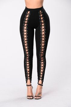 - Available in Black - Fitted Legging - Elastic Waist Band - Criss Cross Front - 95% Rayon 5% Spandex