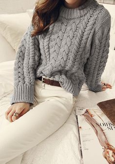 This grey chunky cable-knit pullover, complete with long sleeves and ribbed trim, is perfect for cozy nights by the fire. Pair this slightly...