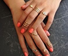 love the idea of having my hands covered in rings like these.