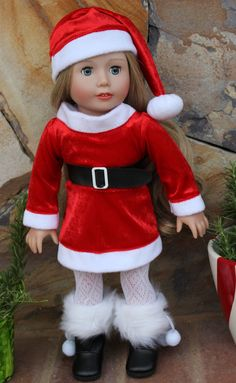 Fits American Girl Doll Santa Outfits with Hat & Boots is at www.harmonyclubdolls.com We fit American Girl. We also offer our own exclusive line of 18 inch Harmony Club Dolls Brand Dolls www.harmonyclubdolls.com