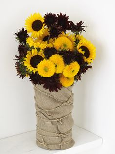 I like the burlap covered vase