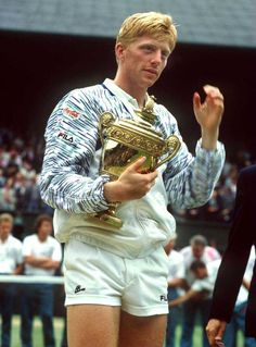 Boris Becker holds the trophy tightly after winning Wimbledon for the third and final time in 1989.
