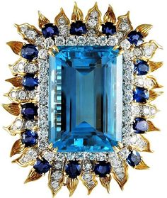 For Sale on - An impeccable and very special brooch centering one exquisite emerald-cut aquamarine weighing approximately cts., edged by and flared detailed leaves Aquamarine Jewelry, Diamond Jewelry, Gold Jewelry, Tiffany Jewelry, Jewellery, Antique Brooches, Antique Jewelry, Vintage Jewelry, Gold Chains For Men