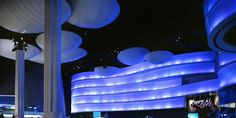 The blue lighting and round hanging lamps give the patrons of the Georgia Aquarium the sense of being underwater. One of our favorite projects to date!