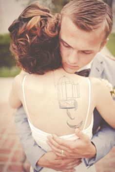 Bride with tattoos birdcages. Pinned this for the back view of her hair, but tattoo is a bonus!